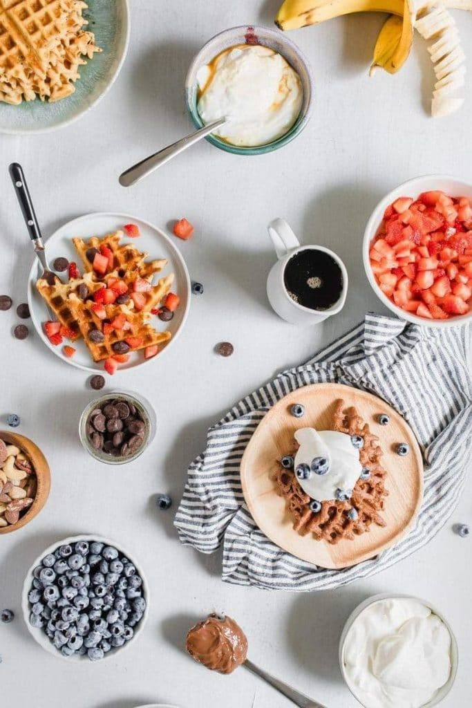 waffles and toppings on a table