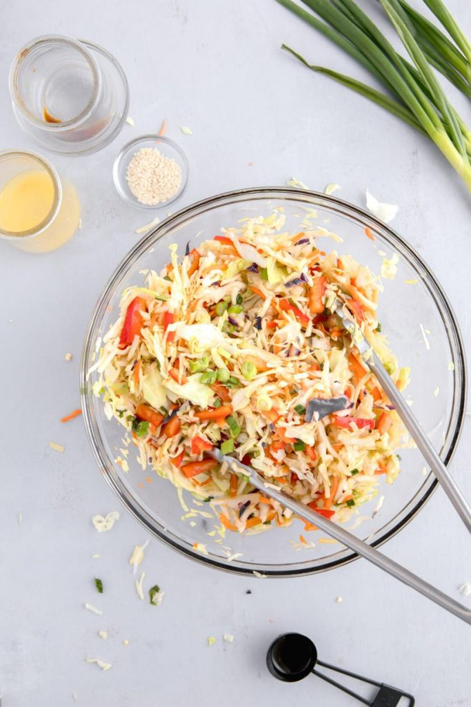 Asian coleslaw in a glass bowl on a table
