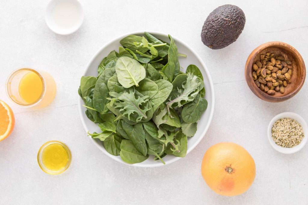 grapefruit and avocado salad ingredients on a table