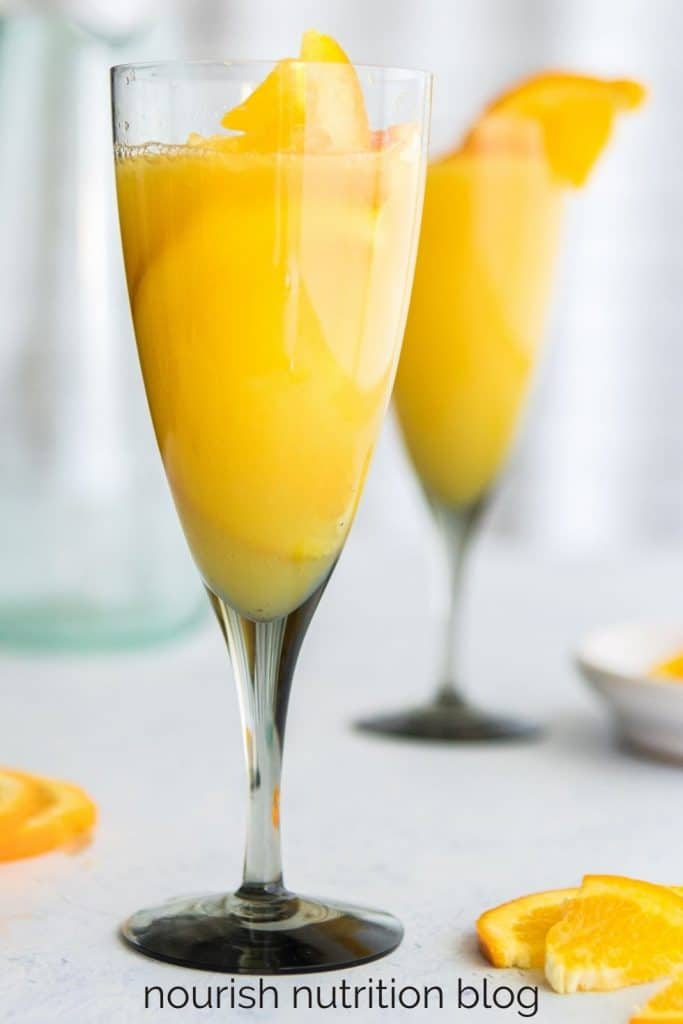 two champagne flutes with juice in them and text overlay