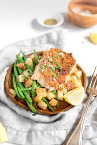 Pan seared pork chops with green beans and potatoes on a plate