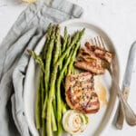 lamb steak with asparagus on a plate