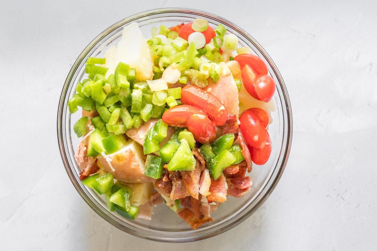 no-mayo potato salad ingredients in a bowl