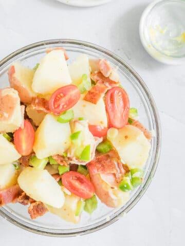 close up photo of no-mayo potato salad in bowl