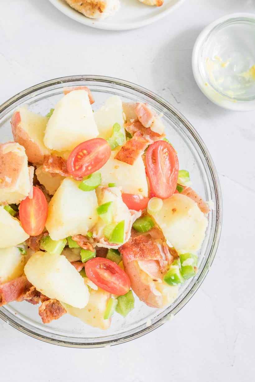 close up photo of potato salad with bacon in bowl