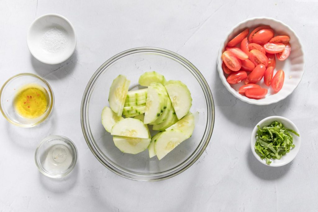 ingredients for an easy cucumber salad on a table