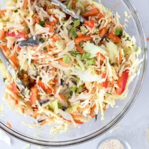 close up of Asian slaw in a glass bowl