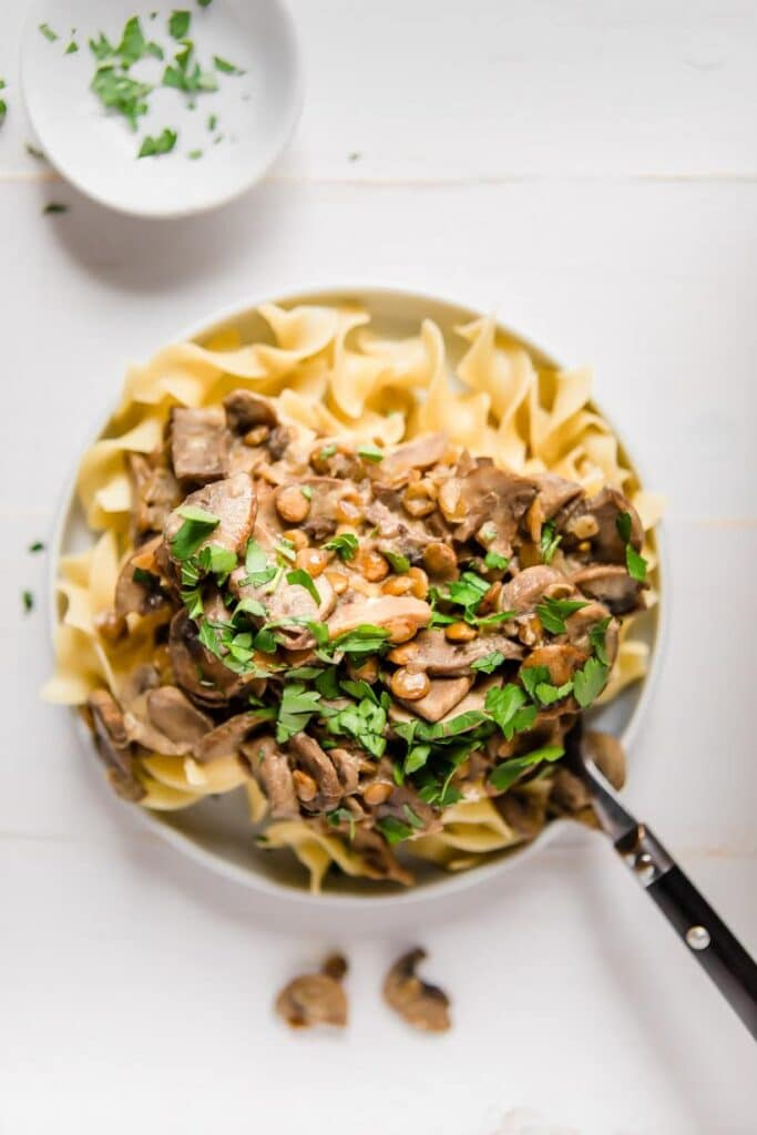 Instant Pot lentil stroganoff on a plate with parsley on top