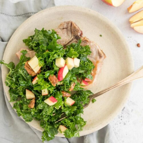 kale, apple and pecan salad on a plate