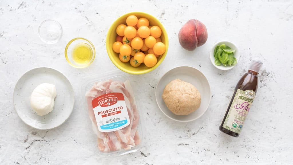 ingredients for peach and prosciutto pizza caprese
