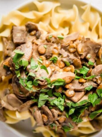 close up of lentil stroganoff with parsley