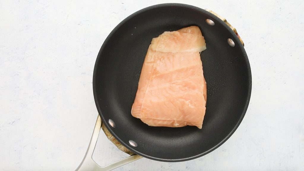 uncooked salmon in pan