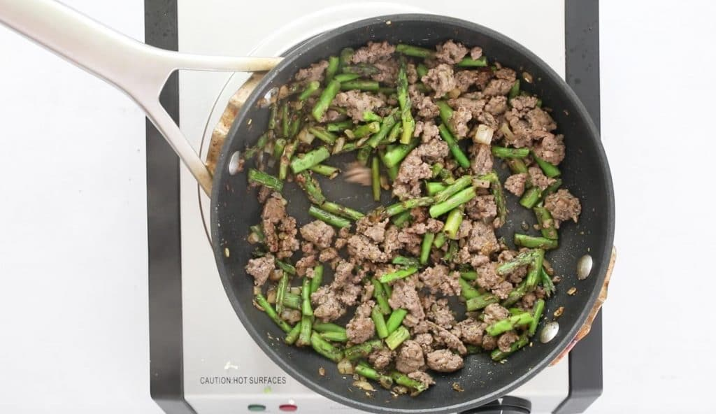 ground beef and vegetables in sautee pan