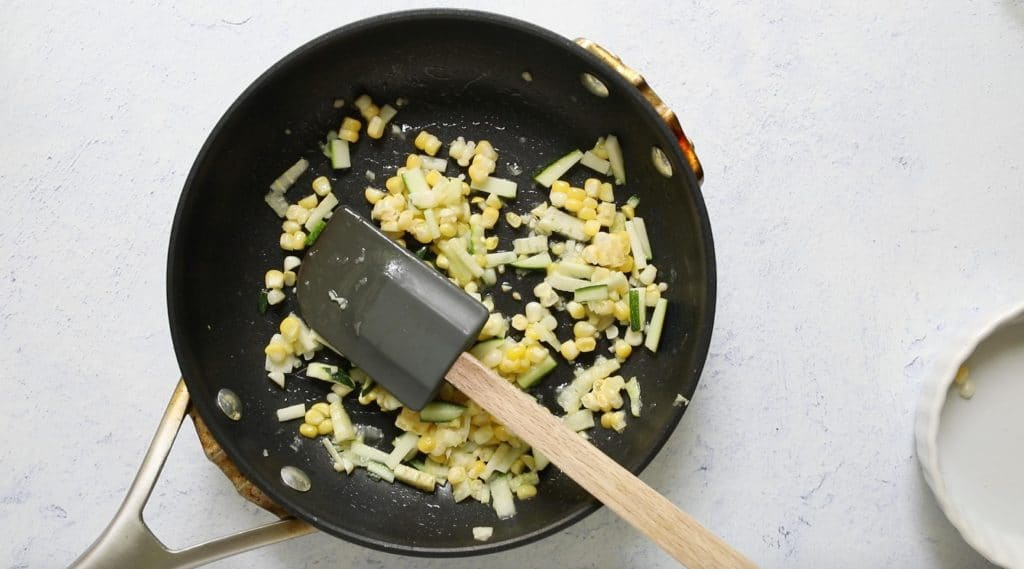 zucchini and corn in a fry pan