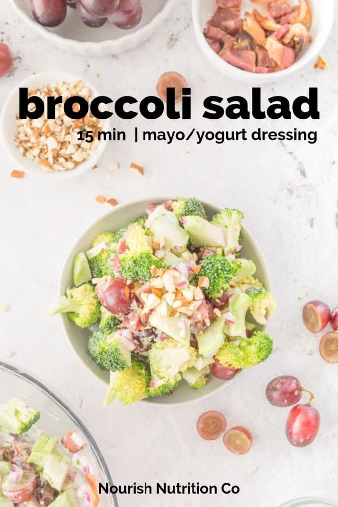 broccoli salad with grapes on a table with ingredients on table with text overlay