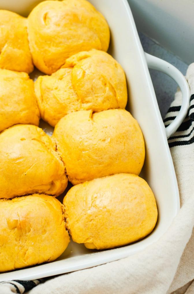 sweet potato rolls in a white baking dish