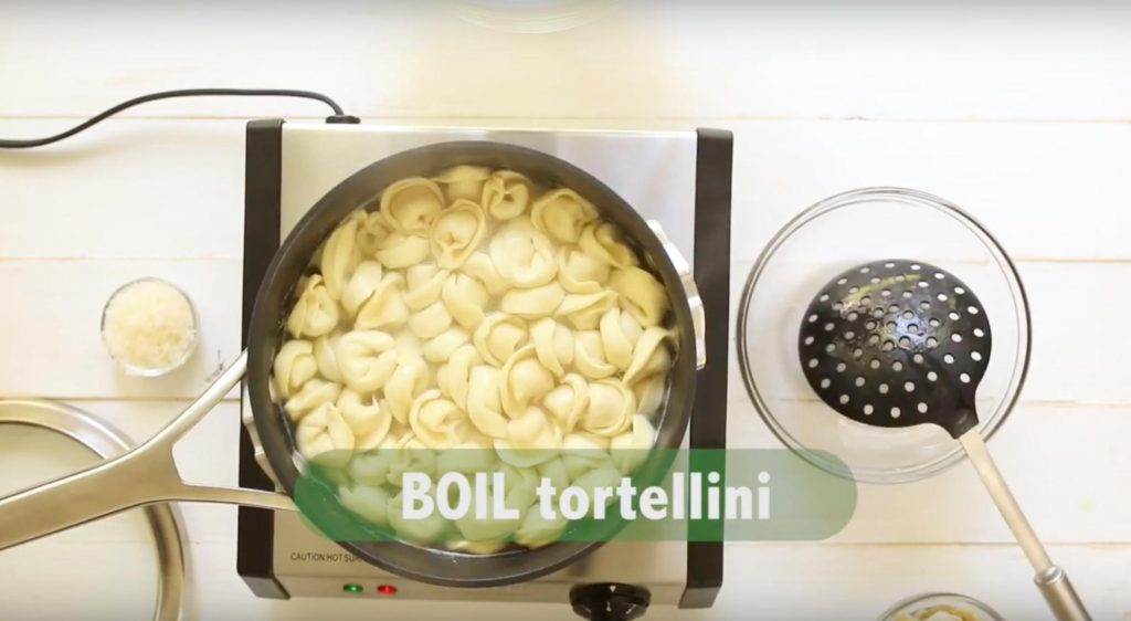 tortellini cooking in a pot with text overlay