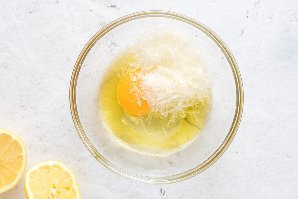 egg and parmesan cheese in a small glass mixing bowl