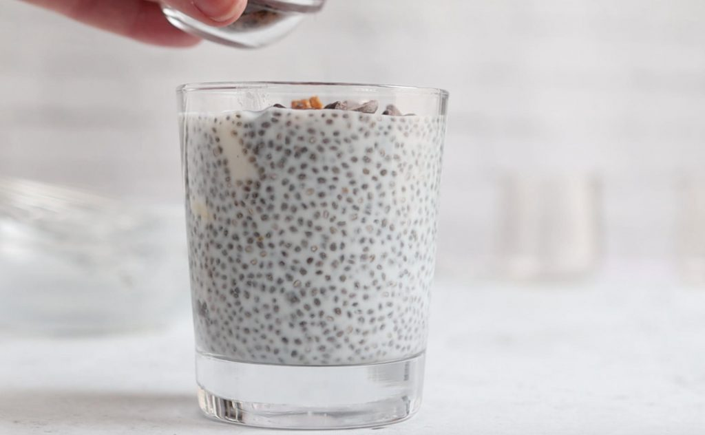 side shot of chia pudding in a short glass