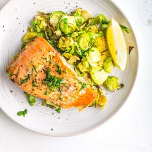 maple mustard salmon and brussels sprouts on a plate