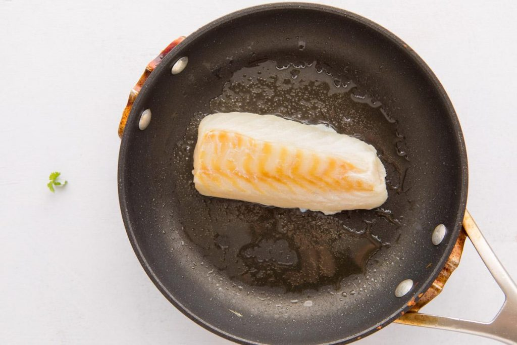 tilapia filet in a small fry pan