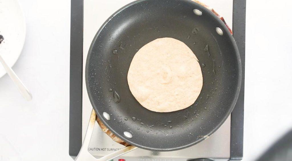flour tortilla in a frying pan