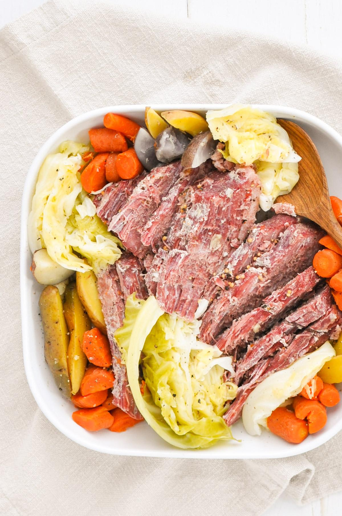 corned beef, cabbage, potatoes, and carrots on a white plate
