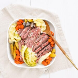 instant pot corned beef and cabbage in a white plate