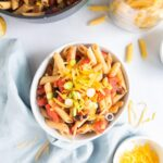 square image of black bean pasta with cheese in a bowl