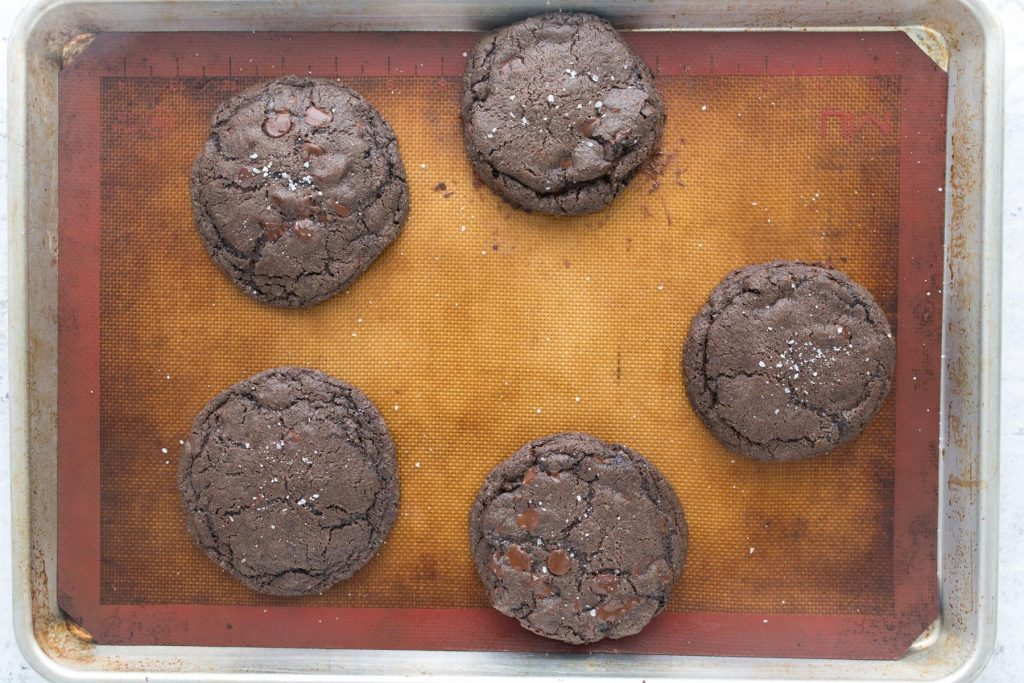 double chocolate cookies on a cookie sheet