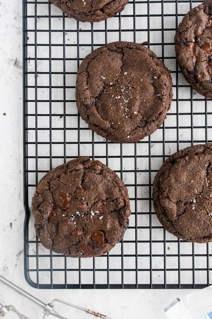 5 dark chocolate small batch cookies on a cookie sheet
