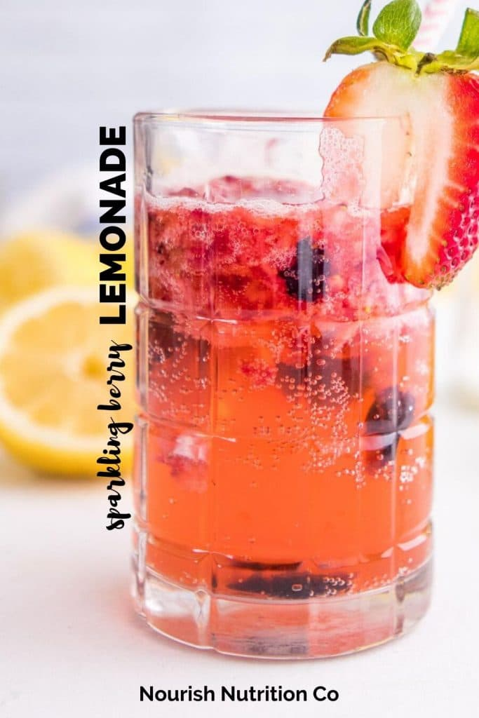 sparkling berry lemonade in a glass with a strawberry and text overlay