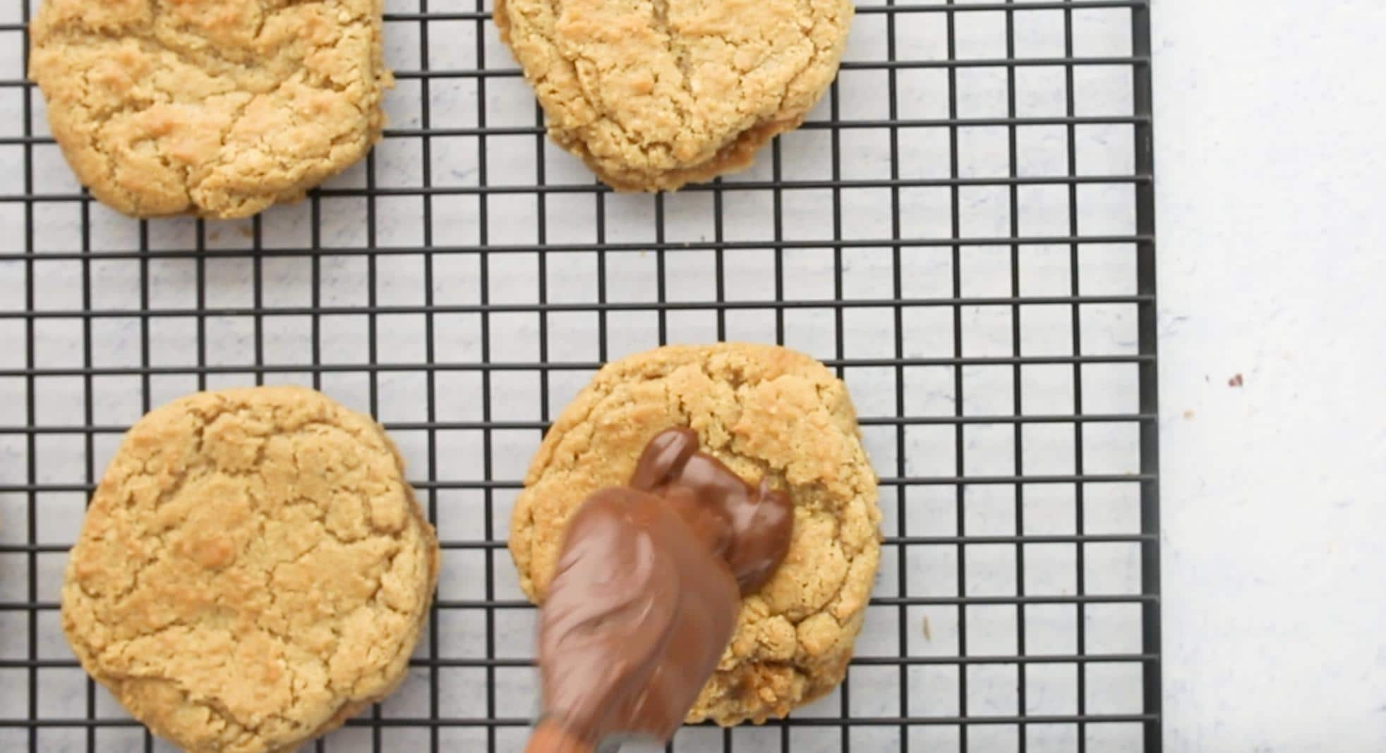 Adding a dollop of chocolate to a peanut butter cookie