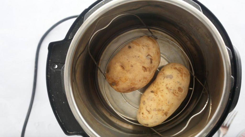 two russet potatoes in an instant pot bowl