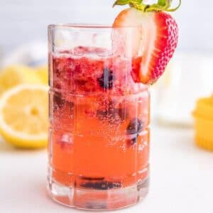 square image of sparkling berry lemonade in a glass