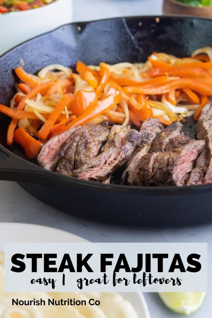 sliced steak, red bell peppers, and onions on a cast iron skillet with text overlay