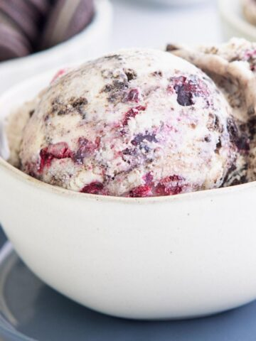 a scoop of blueberry oreo ice cream in a bowl