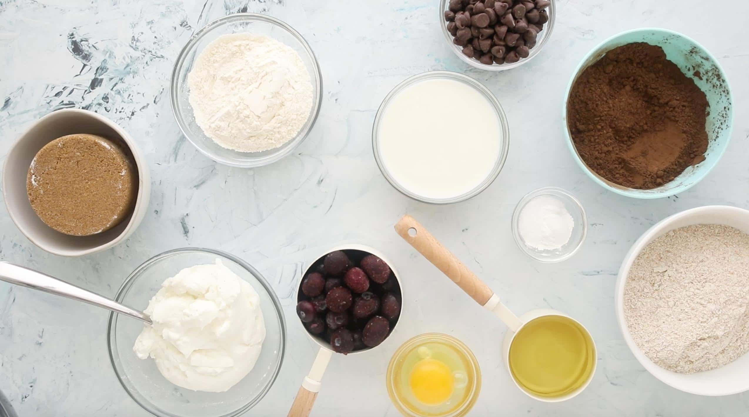 ingredients for chocolate blueberry muffins on a table
