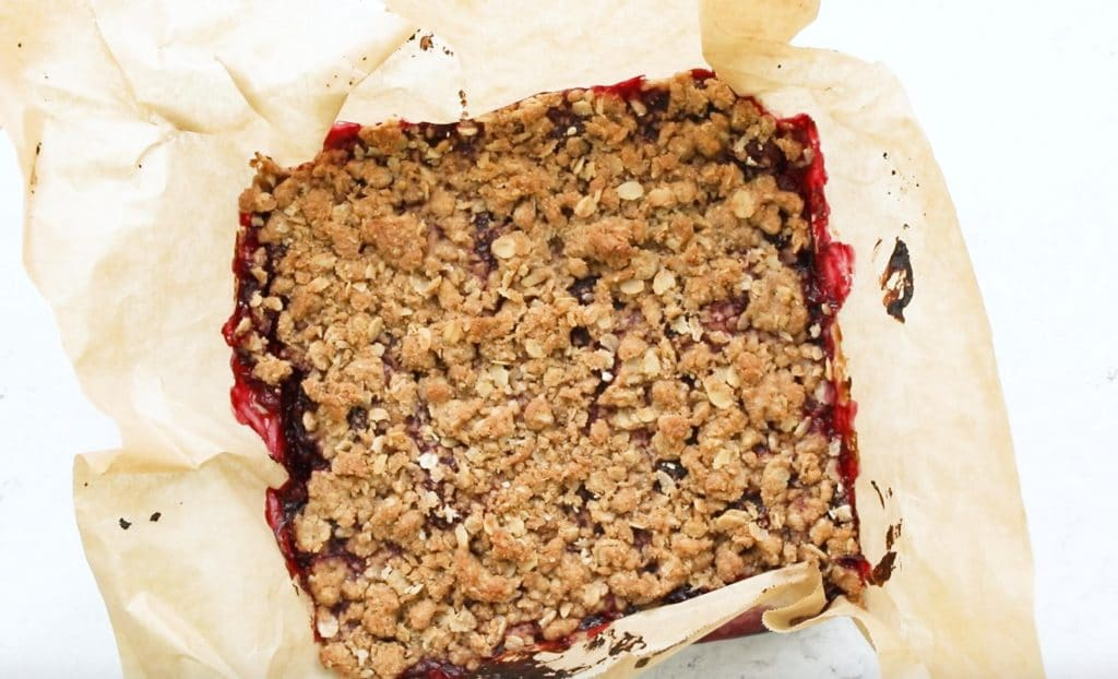 cooked cherry oatmeal bars in parchment paper