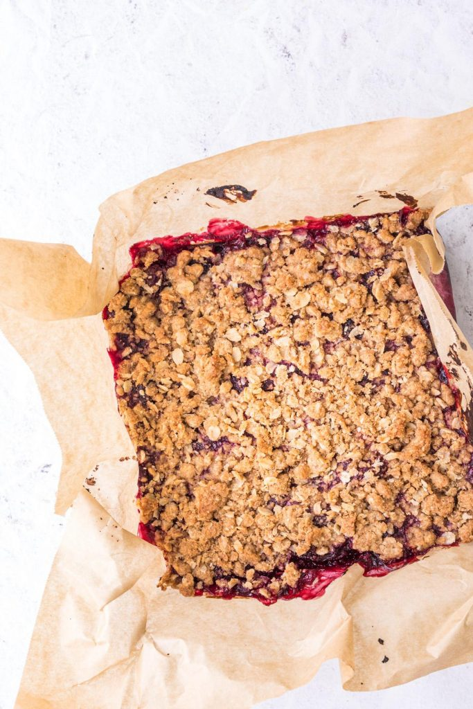 uncut cherry oatmeal bars on parchment paper