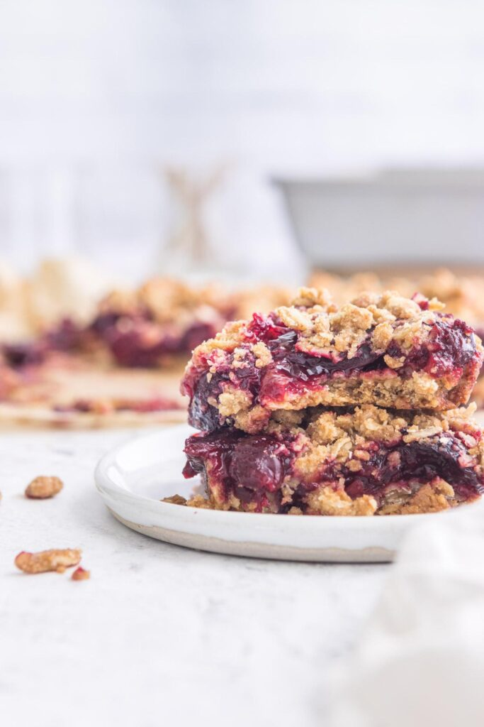 two cherry oatmeal bars stacked with more in background