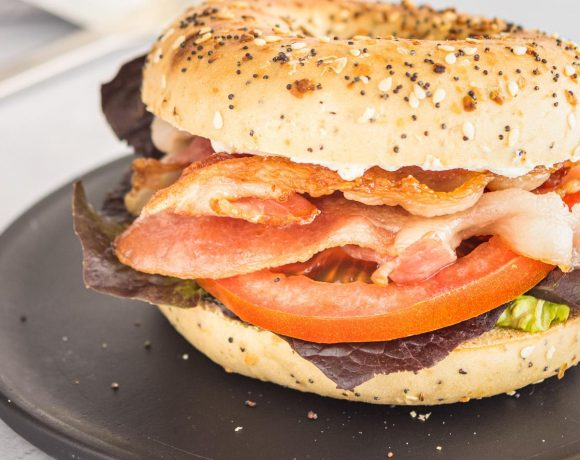 close up of a blt on an everything bagel