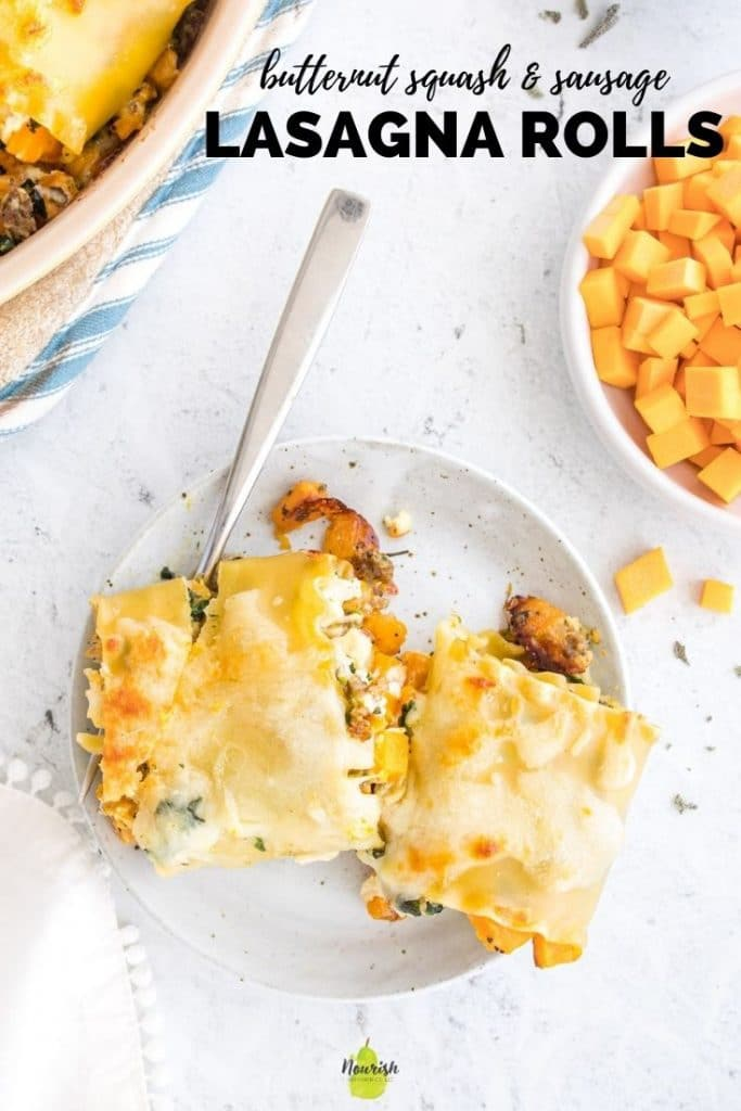 butternut squash lasagna rolls on a plate with ingredients around it and text overlay