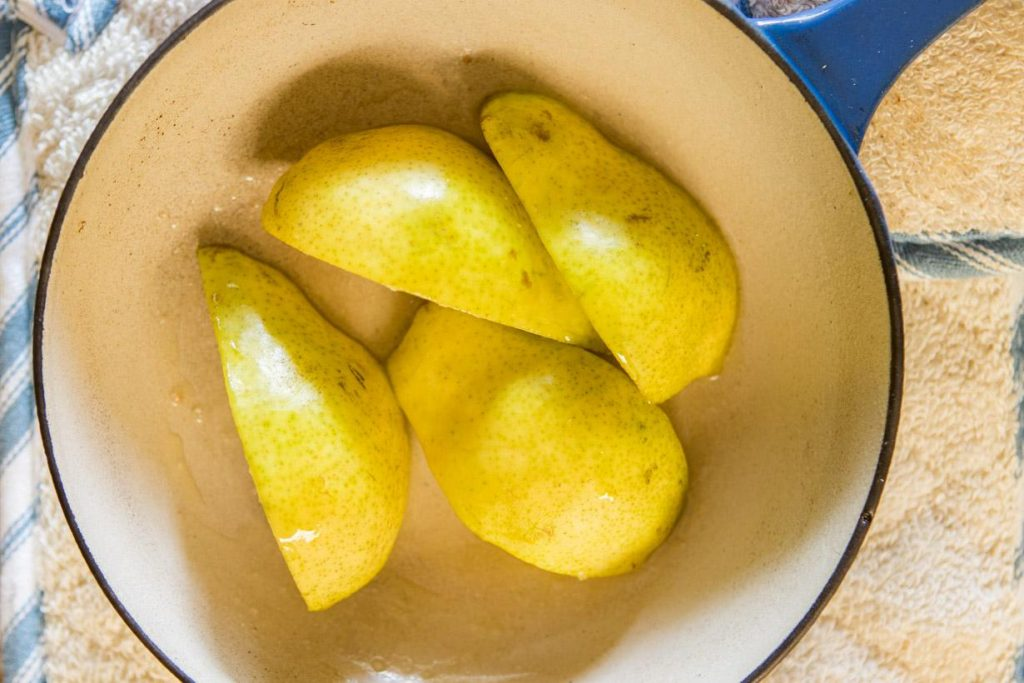 four slice of pear in a small saucepan