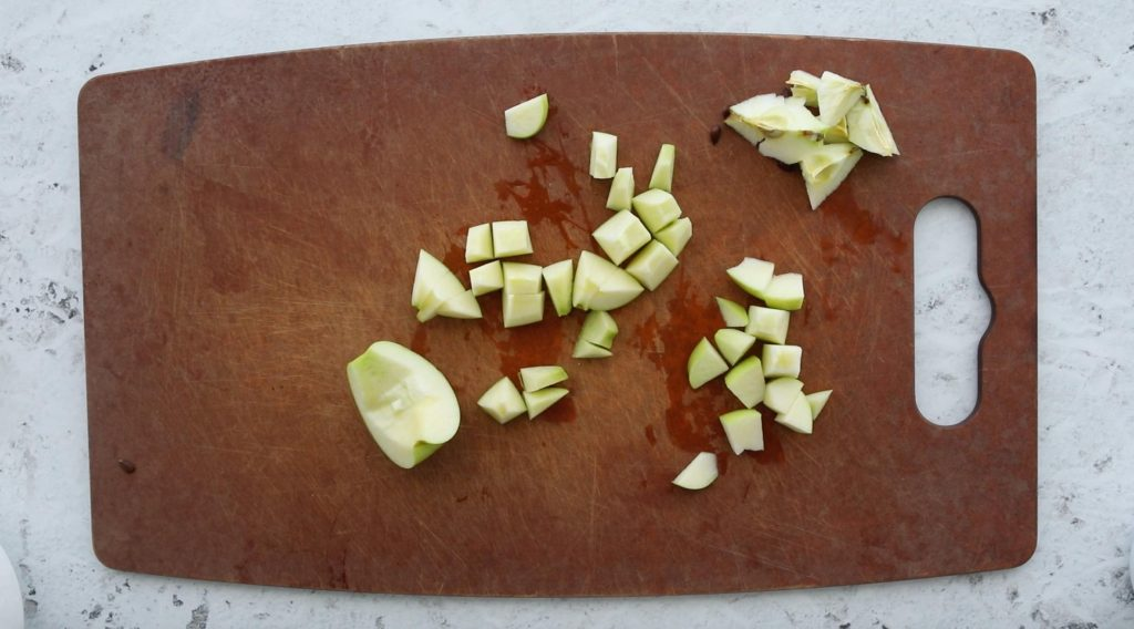 chopped granny smith apple on cutting board