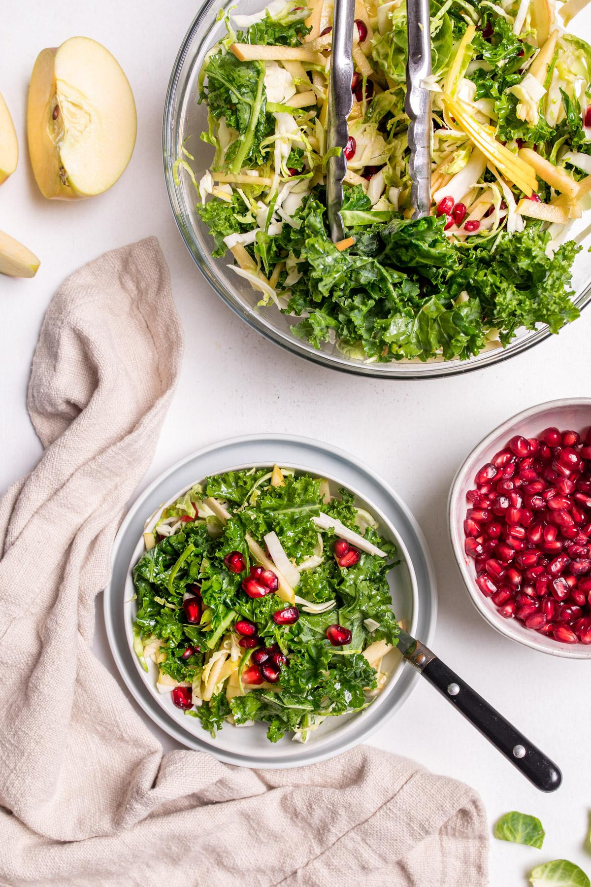 holiday kale slaw with pomegranates on a table