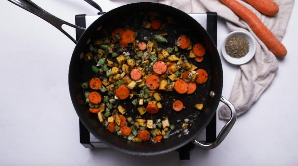 vegetables cooking in a large saucepan