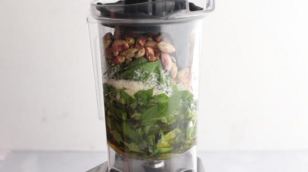 ingredients for pesto in a blender  jar