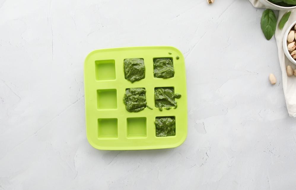 pistachio pesto in a green ice tray