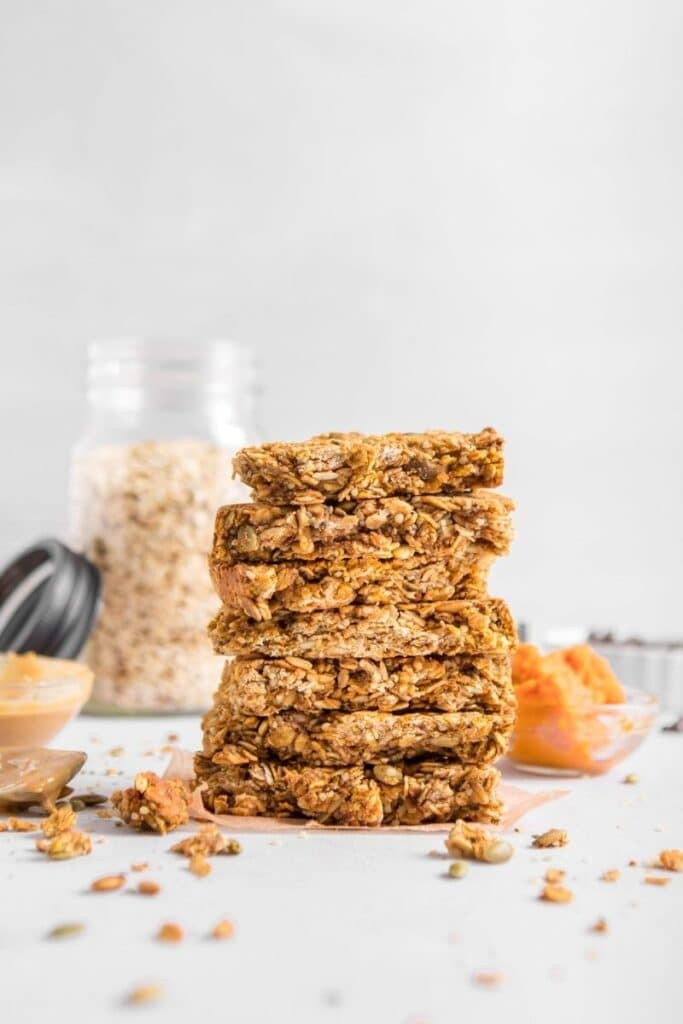 stack of granola bars with ingredients in background
